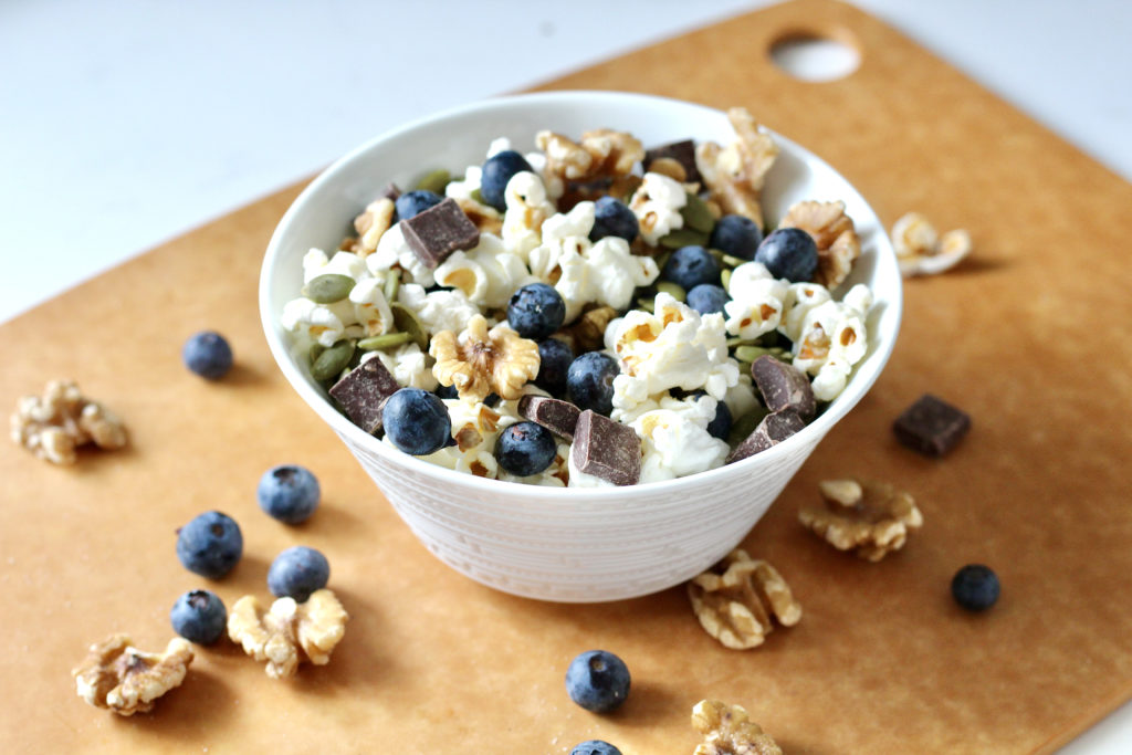 homemade trail mix with blueberries walnuts and popcorn