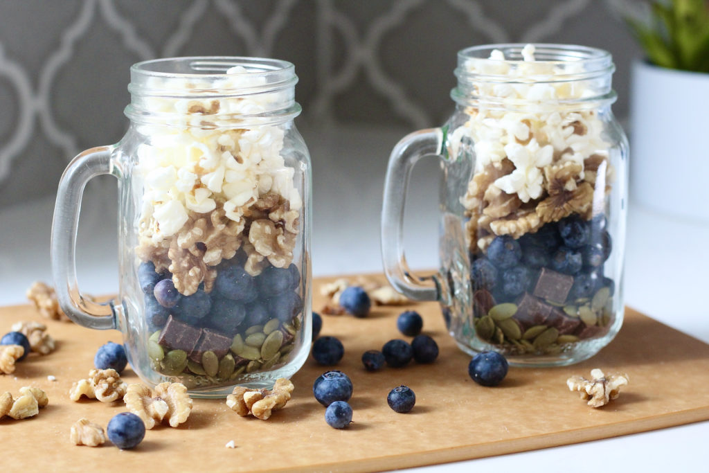 homemade trail mix with blueberries and walnuts in mason jars