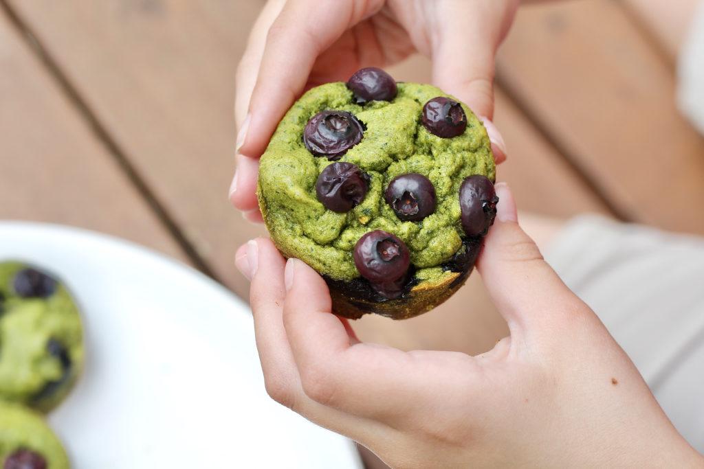 kids hands holding spinach blender muffins