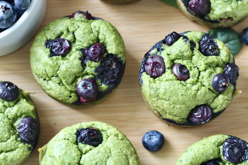 close up of spinach blender muffins with blueberries