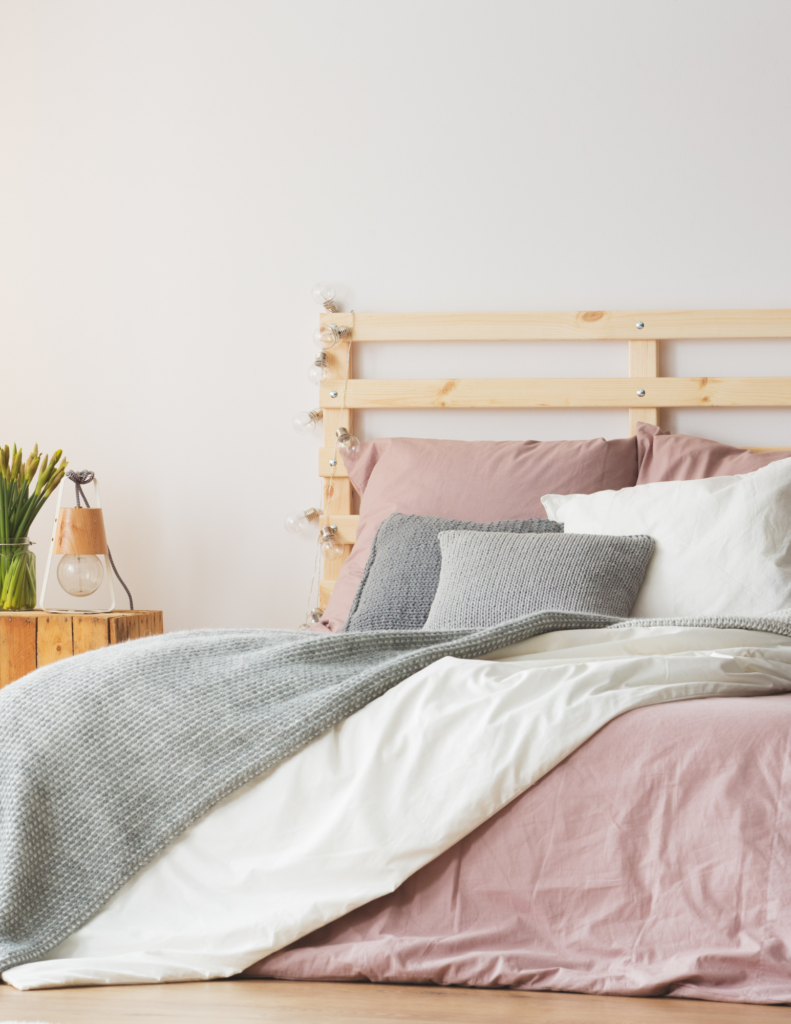 bed with pink blanket and wood frame boost energy for diabetes