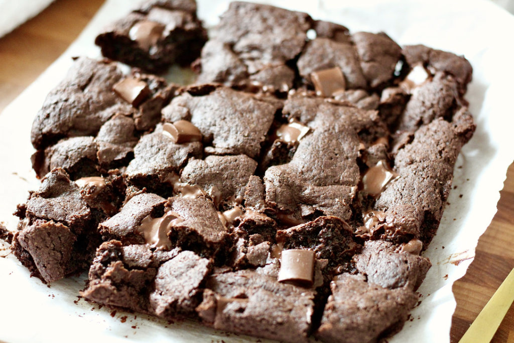 gluten free brownies on parchment paper with chocolate chunks