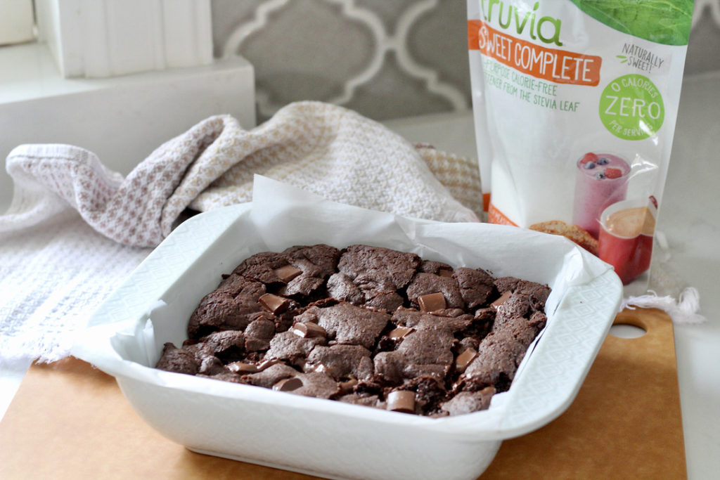 gluten free brownies in white square pan with truvia sweet complete