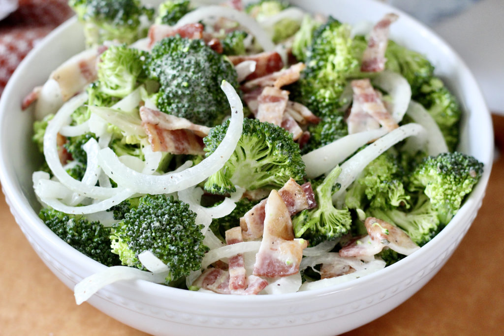 close up of low carb broccoli salad with bacon and vidalia onions
