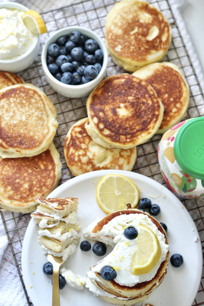 lemon ricotta pancakes on gold baking rack with truvia and blueberries
