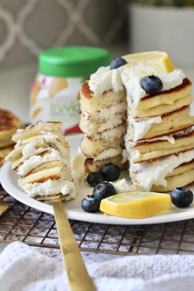 bite of lemon ricotta pancakes on gold fork