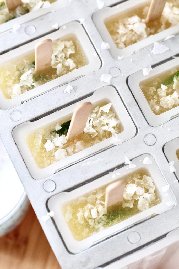sea salt on margarita popsicles in popsicle mold