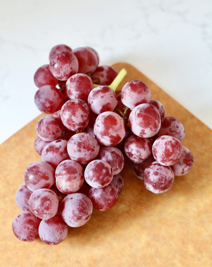 red seedless california grapes on cutting board