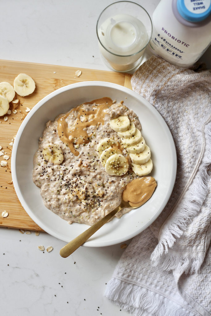banana peanut butter overnight oats in white bowl with kefir