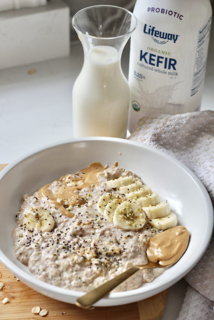 peanut butter overnight oats in white bowl with bananas