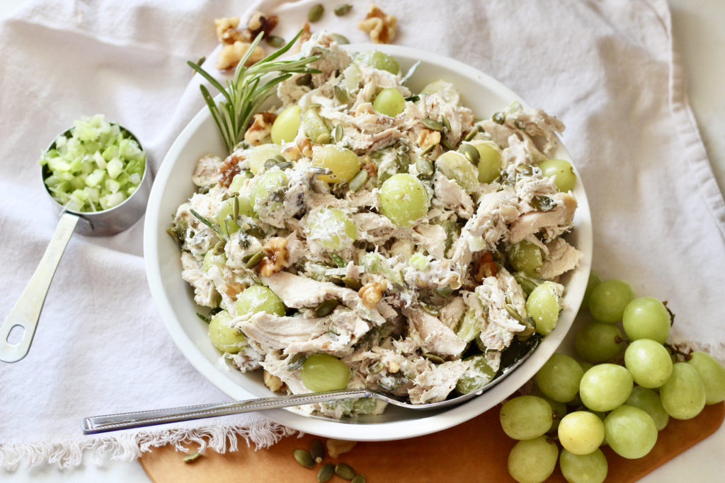 chicken salad with grapes and walnuts silver serving spoon white lecreuset serving bowl
