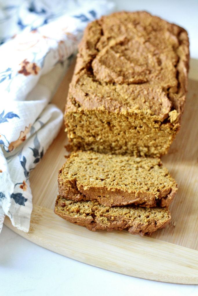 gluten free pumpkin bread on wood cutting board