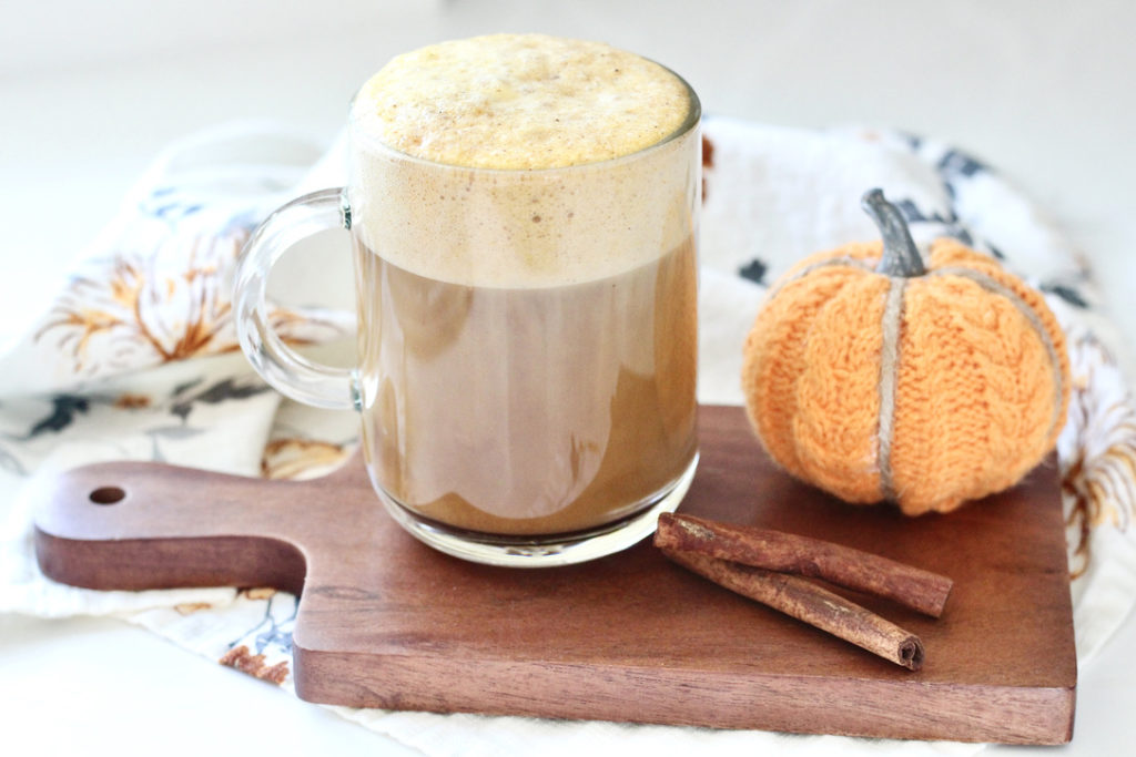 healthy pumpkin spice latte without whipped cream on cutting board