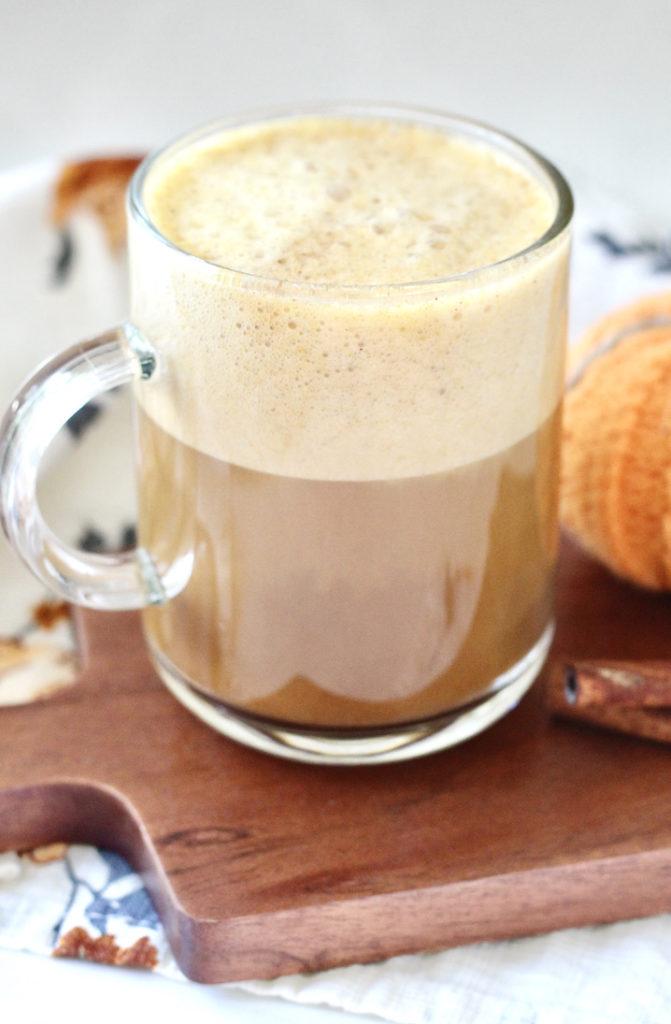 healthy pumpkin spice latte in clear coffee cup
