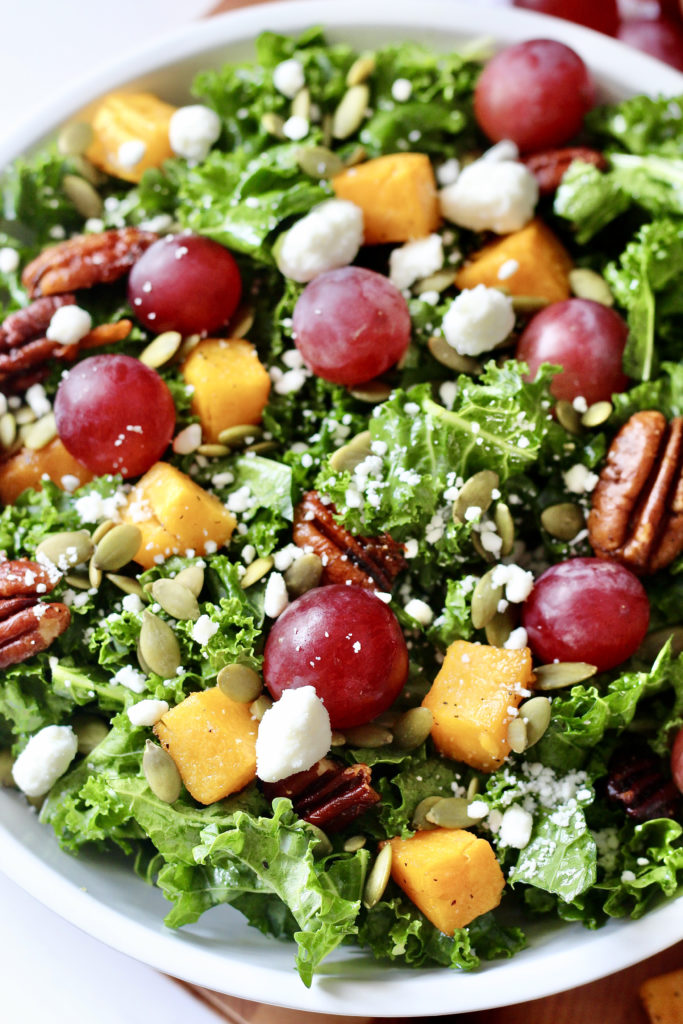 fall harvest salad with grapes butternut squash kale pecans and goat cheese