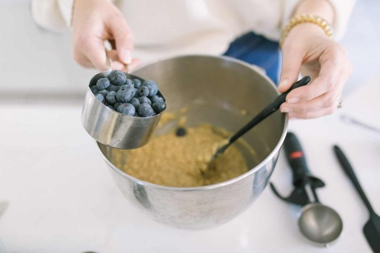 blueberries into bowl baking muffins